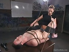 Cruel domina Audrey Leigh strapon be hung up on anal hole of man with plighted balls