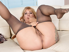 Puristic milf Joclyn Stone gets turned on in pantyhose