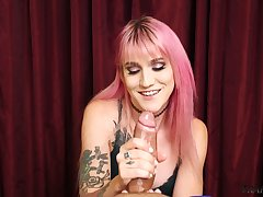 Pink haired slutty shemale Lena Kelly shows off her cock jerking skills