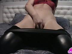 Brunette involving leather tights masturbates