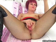 Mature lady with purple hair, Penny Brooks likes to masturbate in front of the camera