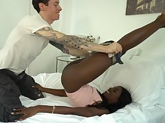 Black beauty Ana Foxxx spreads her arms for a large white flannel