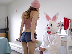 A man dressed in an Easter bunny costume fucks two bad girls