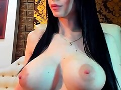 Busty curly brunette with big boobs fucks on vis-�-vis